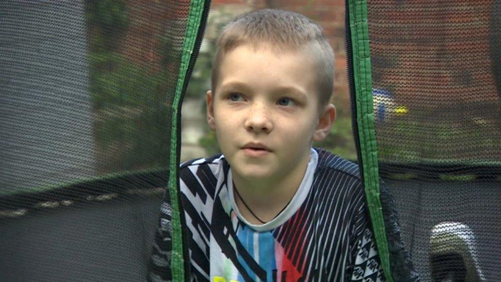 Max Clark lying on his trampoline