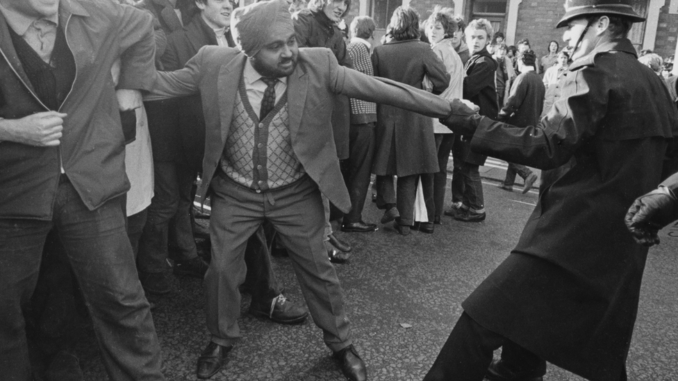 Anti-apartheid demonstrators in the UK clash with police following a rugby match with a South African team in 1969.