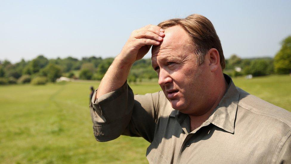 Alex Jones scratching his head - 2013