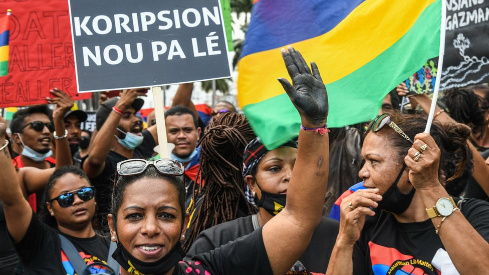 People protest against the government's response to the oil spill disaster that happened in early August, at Place d'Armes near Prime Minister's Office in Port Louis, on the island of Mauritius, on August 29, 2020.