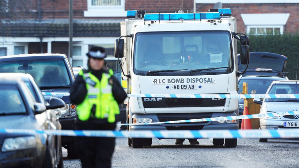 Police and the Bomb Disposal Unit outside a property in Chesterfield, Derbyshire