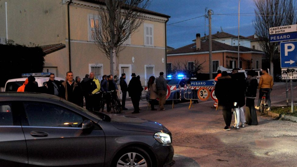 Police secure the area where a World War II explosive device was found in Fano