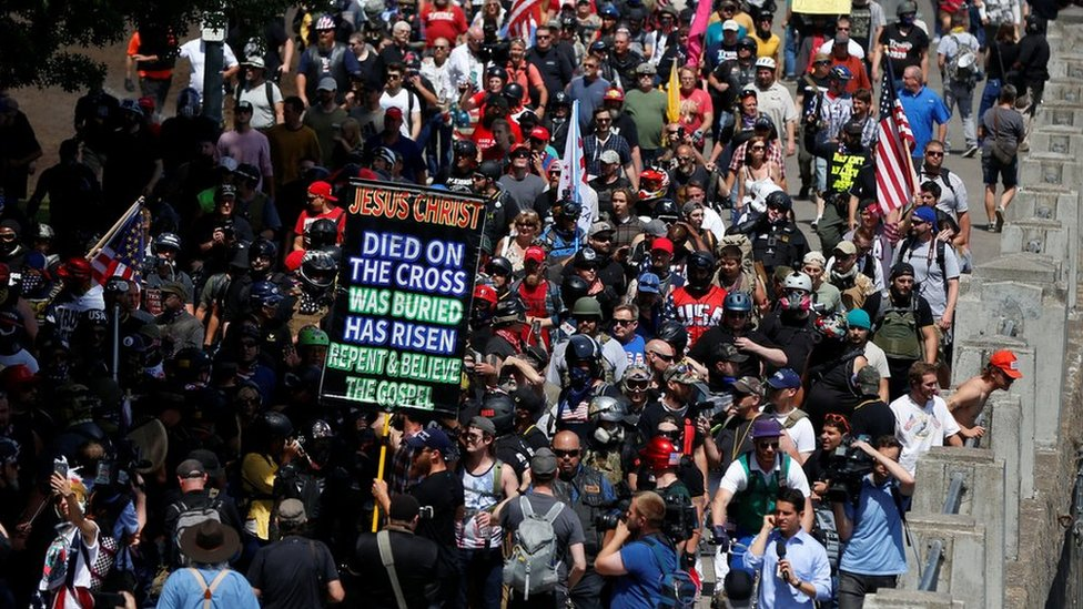 Right-wing supporters of the Patriot Prayer group march during a rally in Portland, 4 August