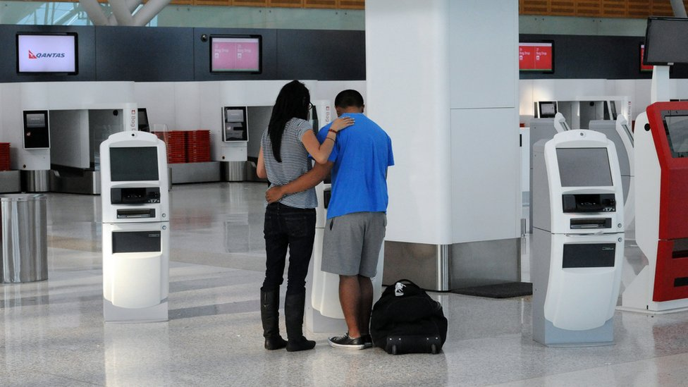 A lone couple at an airport terminal in Sydney