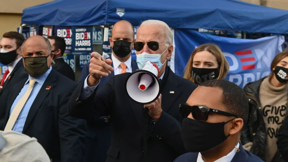 Democratic presidential candidate Joe Biden greets supporters in Philadelphia, Pennsylvania, on November 3, 2020.