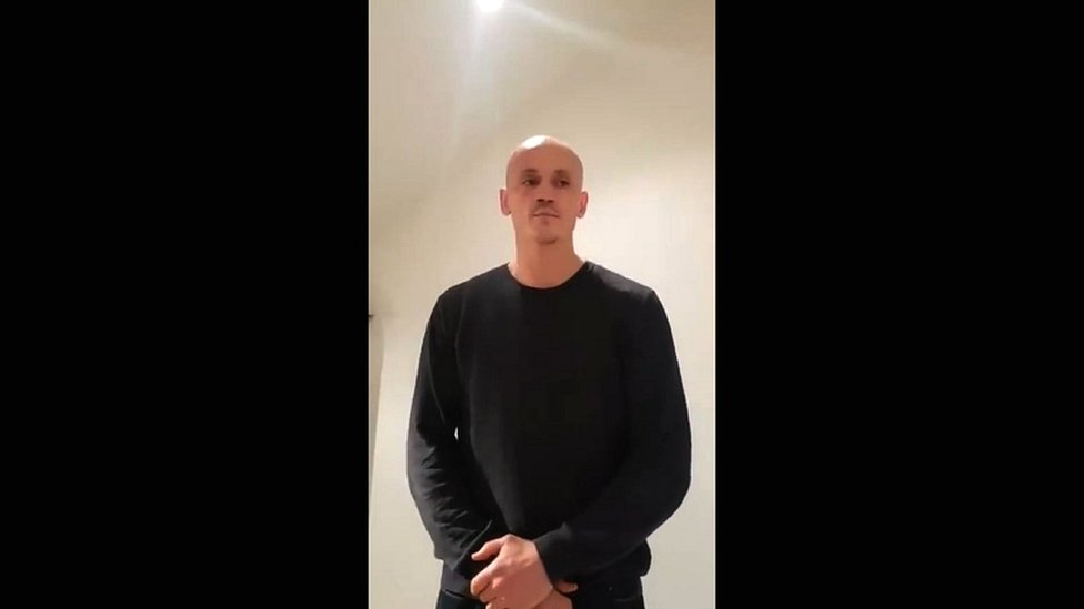 "A video grab made on 7 January 2019 shows former boxer Christophe Dettinger broadcasting a message of apology for punching police officers during a ""yellow vest"" protest in Paris"