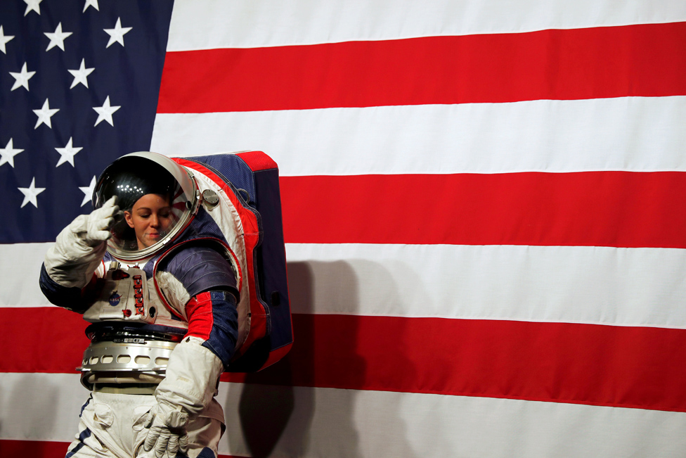 Advanced Space Suit Engineer Kristine Davis wears the xEMU prototype space suit during its presentation at NASA headquarters