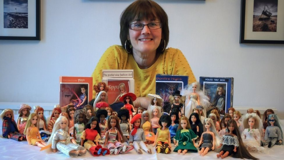 Heather Swann with her collection of Pippa dolls