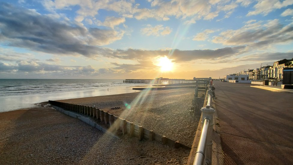 The sun shines over the sea front in Hastings - with nary a bar chart in sight