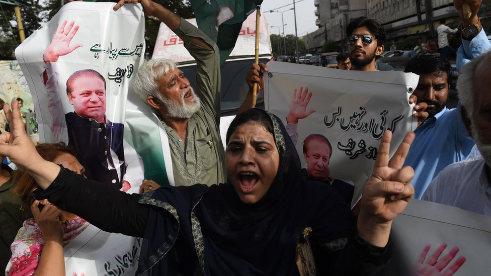 Activists of Pakistan Muslim League-Nawaz (PML-N) shout slogans after the sentencing of Nawaz Sharif, during a protest in Karachi on July 6, 2018