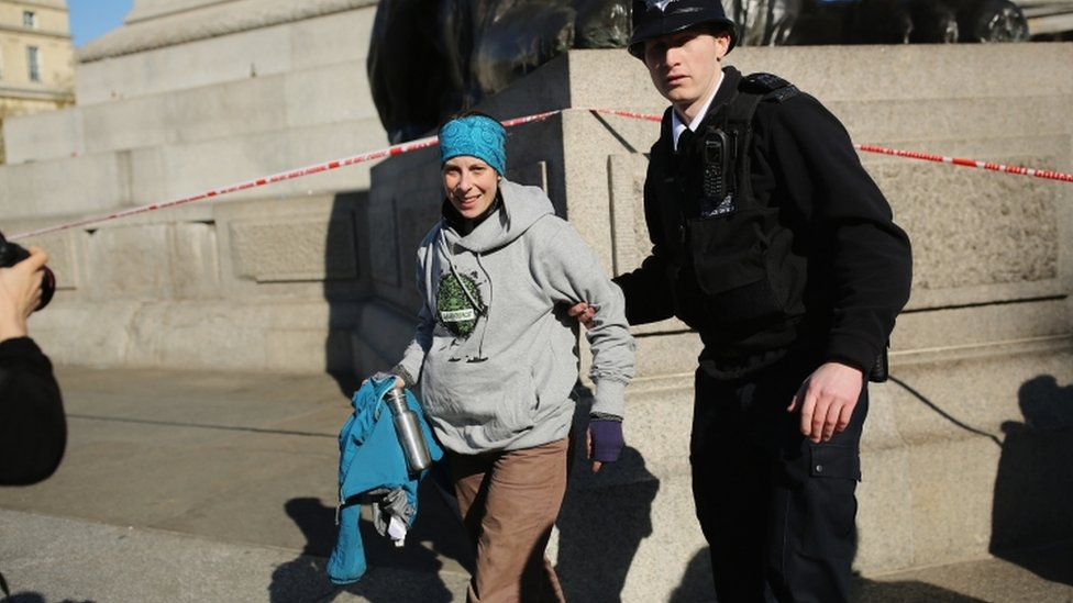 Greenpeace activist Alison Garrigan was arrested after climbing Nelson's Column in Trafalgar Square