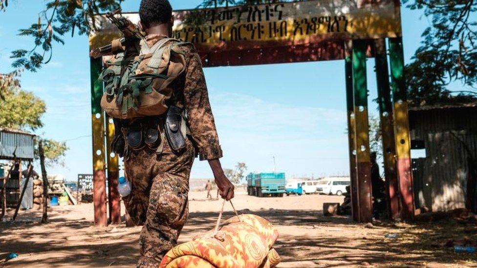 An Ethiopian solider carrying a mattress - November 2020