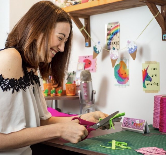 Becci Mai works on one of her designs