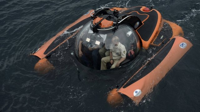 Russian President Vladimir Putin (R) is seen inside a research bathyscaphe while exploring the waters of the Black Sea