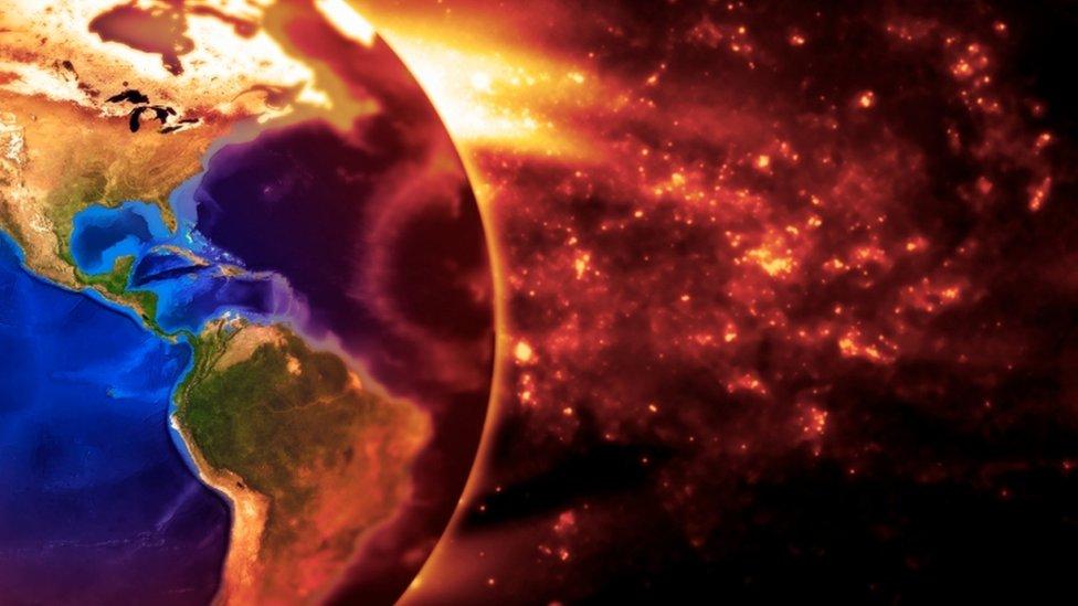 Imagen conceptual de la Tierra ardiendo lentamente debido a la contaminación.