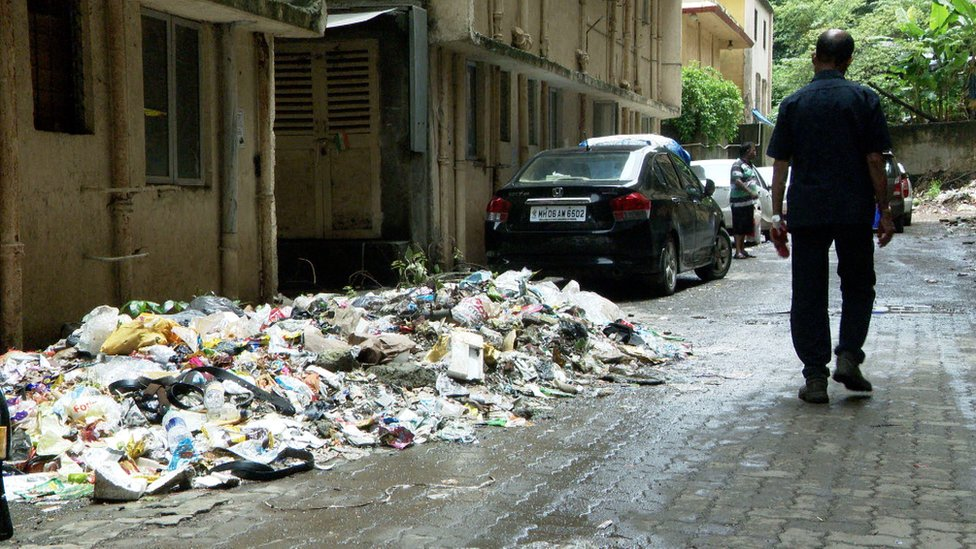 A pile of rubbish alongside houses in Mahul