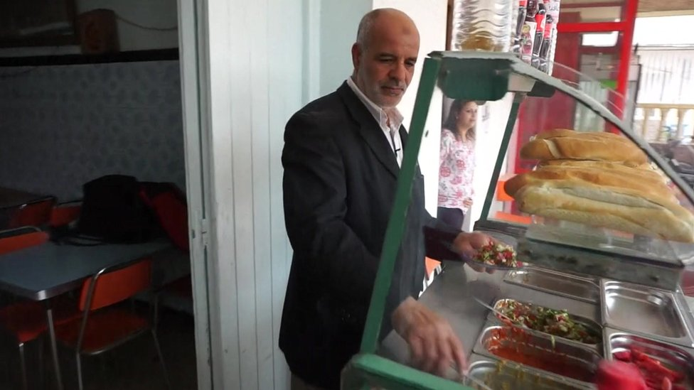 Hakim cooking in his restaurant