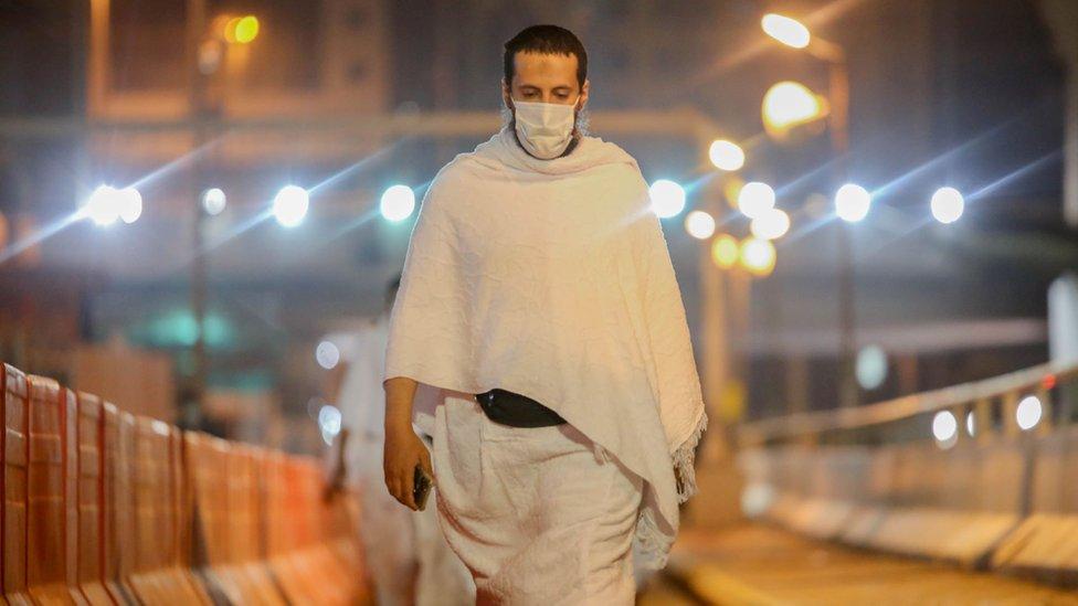 Muslim pilgrim wears a face mask during the Umrah pilgrimage on 3 October 2020