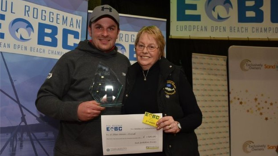 Chris Fisher receives prize
