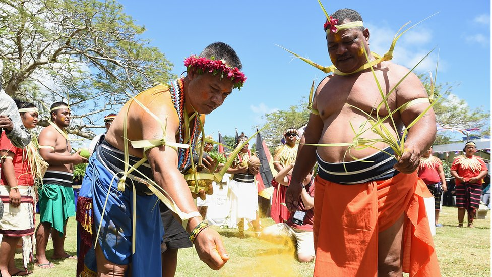Guam islanders at a blessing ceremony