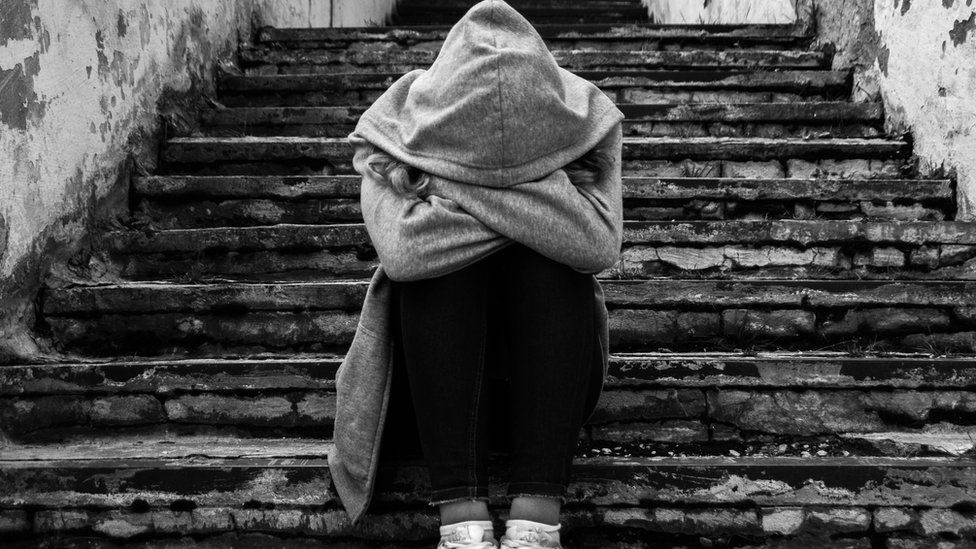 Young woman in hoodie