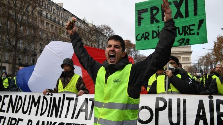 France yellow vest protests: Macron promises wage rise