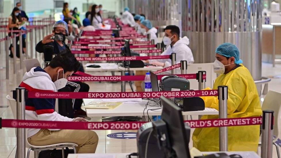 Tourists are tested for Covid-19 on arrival at Dubai's international airport (July 2020)