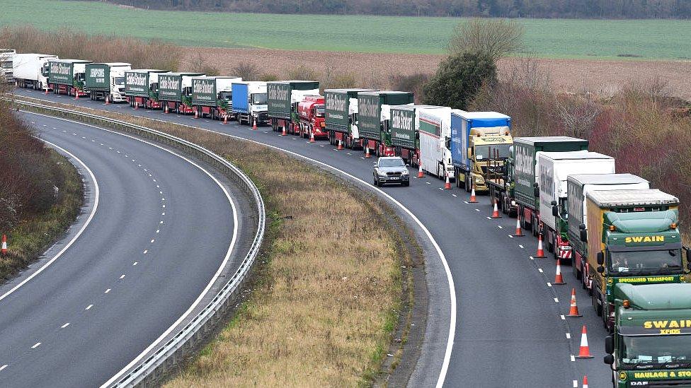 queue of lorries in traffic