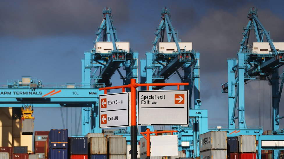 A general view of shipping containers and cranes which move them at the Port of Rotterdam