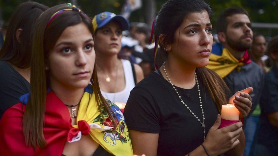 Venezuelans protest against President Nicolas Maduro, in Caracas, on July 31, 2017.