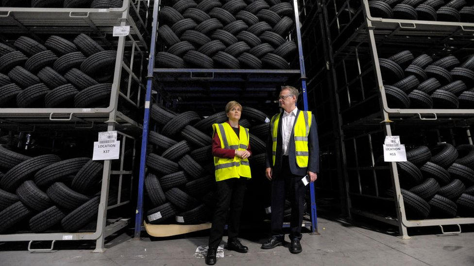 Nicola Sturgeon with Michelin factory manager John Reid in June 2017