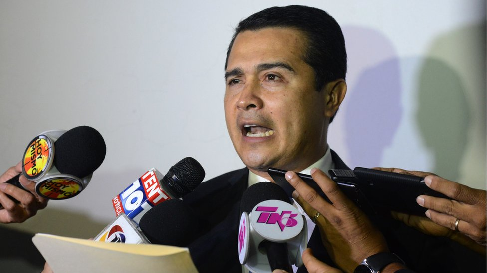 Juan Antonio Hernandez speaks with the press upon arrival at the Toncontin international airport from the United States, on October 25, 2016 in Tegucigalpa