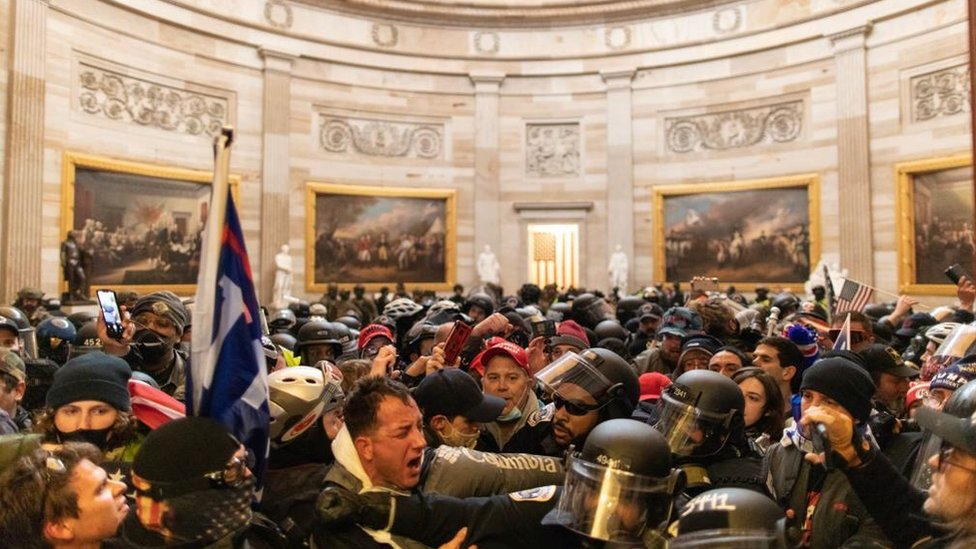 Police confront rioters who entered Capitol Hill buildings