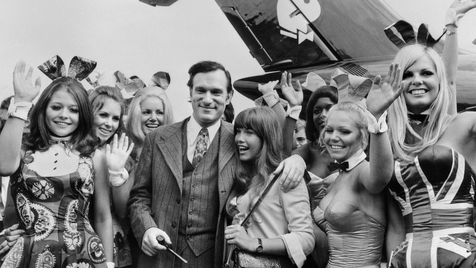 """Photo taken on August 30, 1970 shows US Playboy Magazine publisher Hugh Hefner (top), his girlfriend actress Barbara Benton and other playmates arriving at Le Bourget airport with the Playboy jet """"Big Bunny"""""""