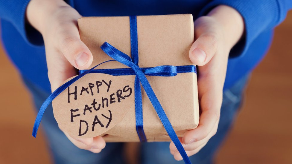 A child holding a father's day present