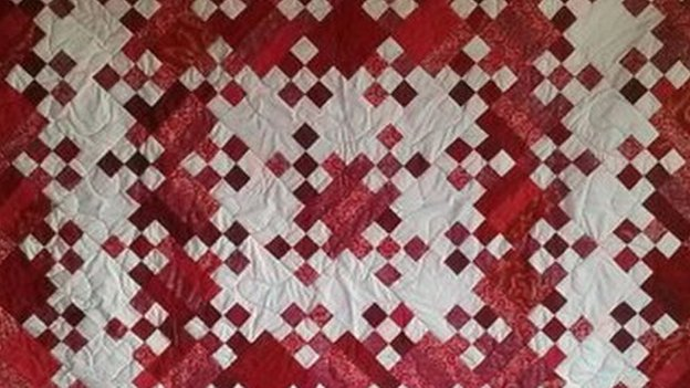 A traditional style quilt made by the artist Eric Suszynski