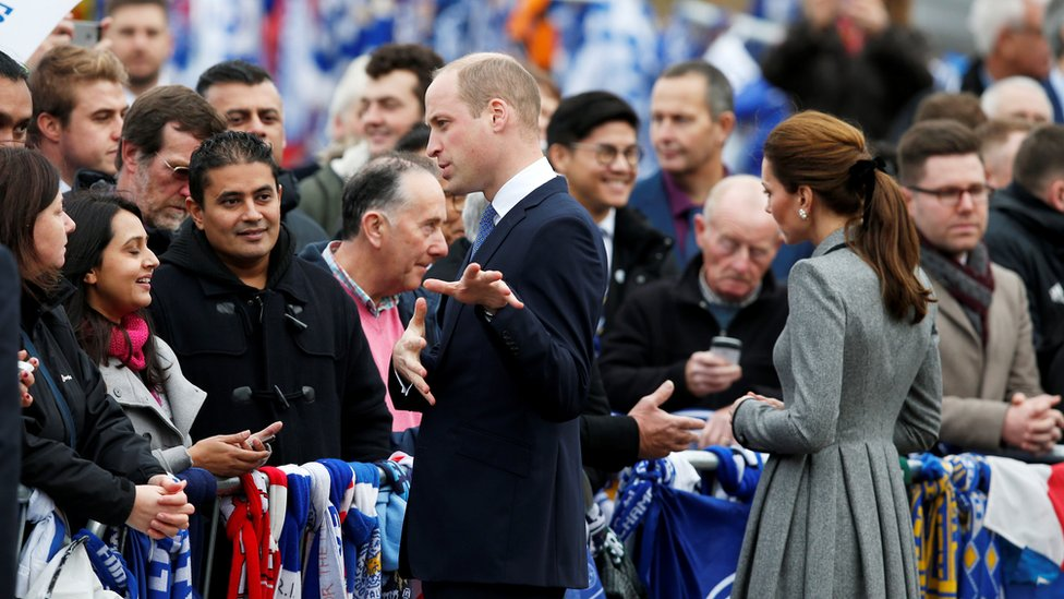 Prince William and Catherine talking to the crowd
