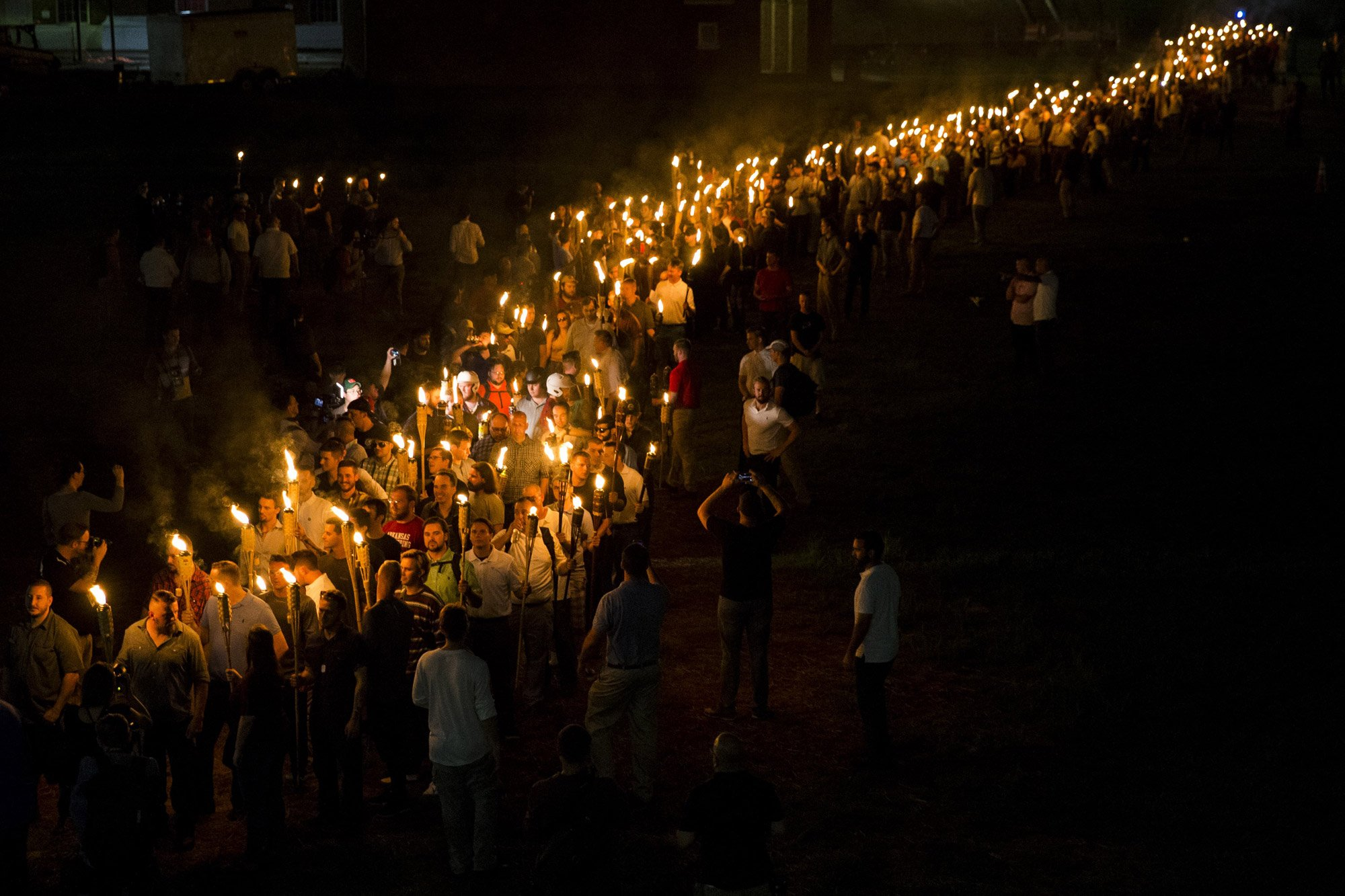 White nationalists march through the University of Virginia Campus with torches in Charlottesville, USA. August 2017