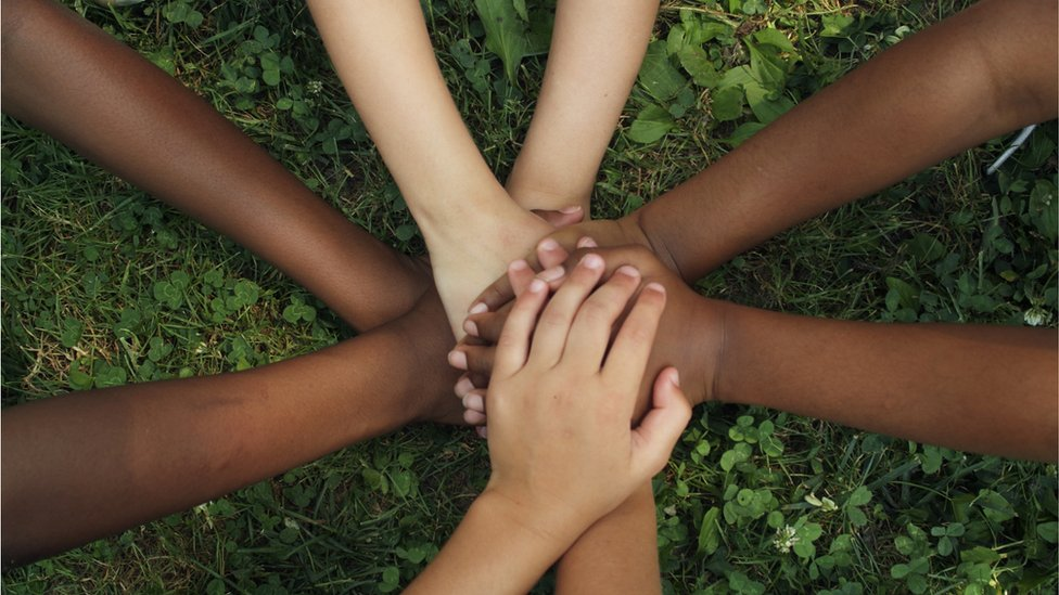 Group of children join hands