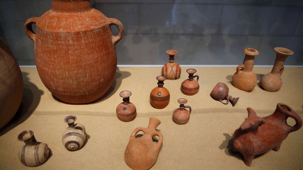 Clay items unearthed during excavations at the first-ever Philistine cemetery in Ashkelon National Park, are displayed at an exhibition in the Rockefeller Museum in Jerusalem July 6, 2016.
