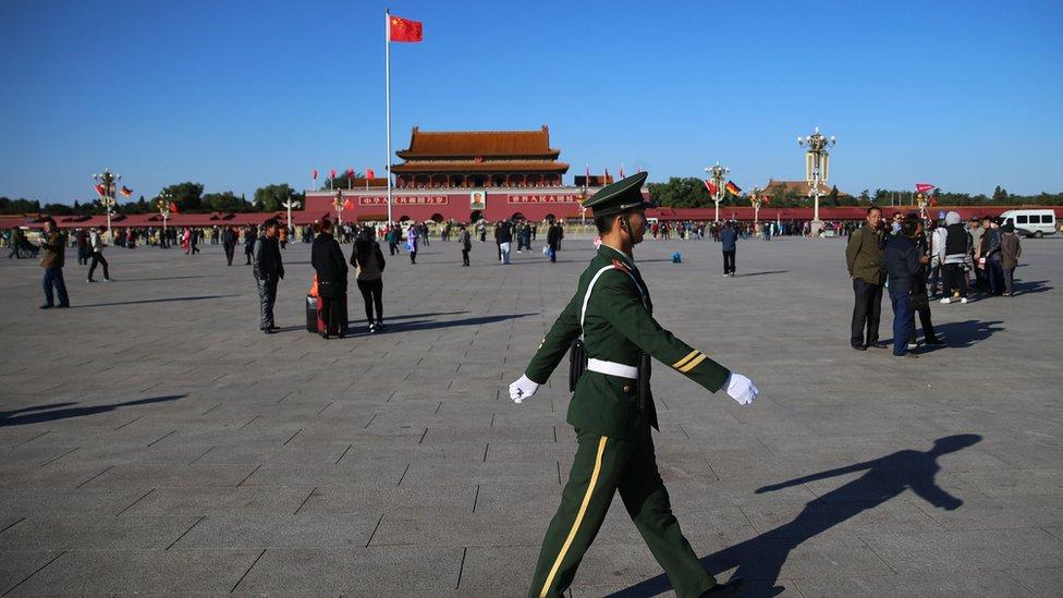A paramilitary officer patrols Tiananmen Square in Beijing, China, 29 October 2015.