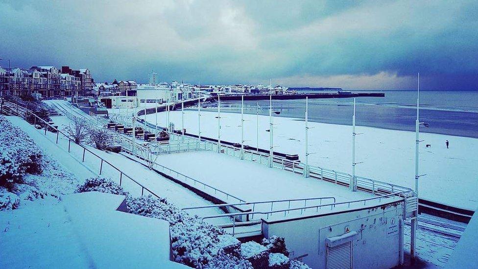 Snow falls on England's east coast beaches