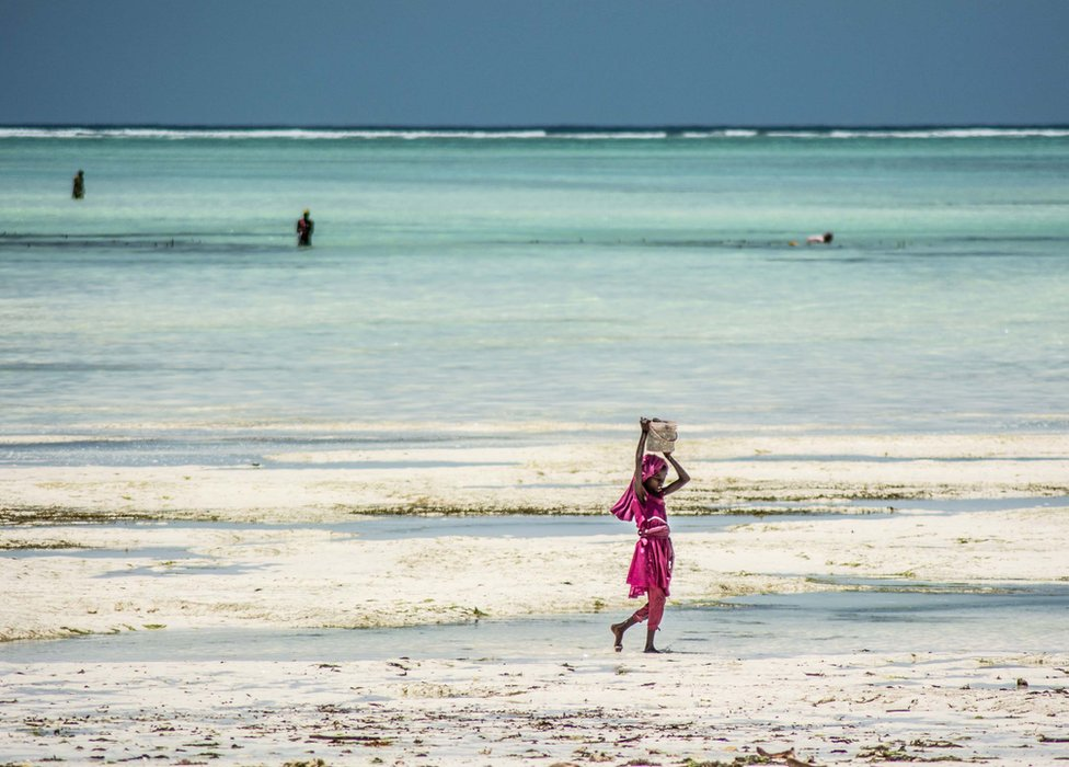 A young girl returns to shore at Paje Beach