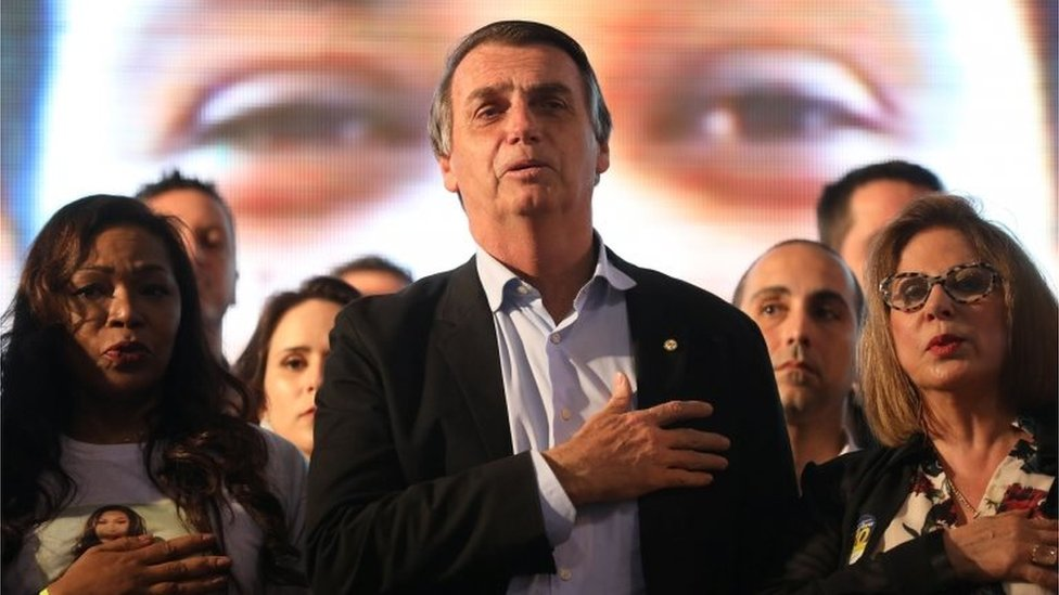 Presidential candidate Jair Bolsonaro listens to the national anthem during a meeting with women in Porto Alegre on 30 August, 2018.