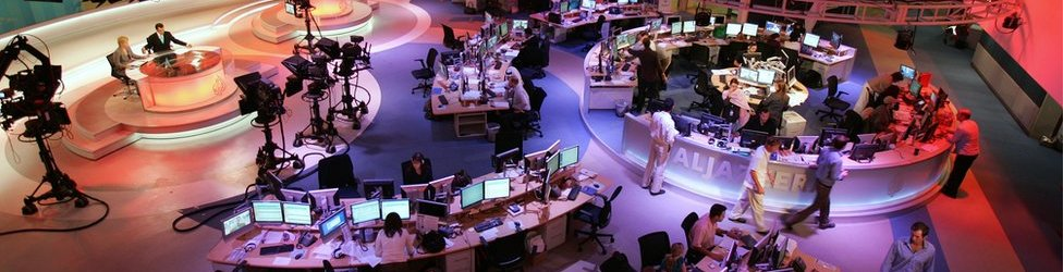 A general view shows the newsroom at the headquarters of the Qatar-based Al-Jazeera satellite news channel in Doha 14 November 2006.