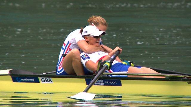 Helen Glover hugs Heather Stanning in their boat
