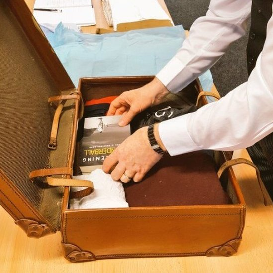 Butler packing suitcase