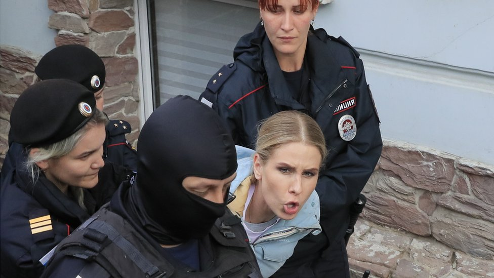 Law enforcement officers detain Russian opposition figure Lyubov Sobol near her office in Moscow
