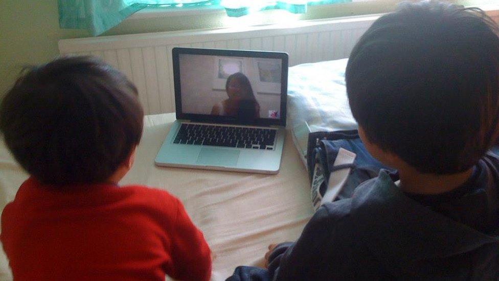 Molly Russell on the computer screen with her two sons