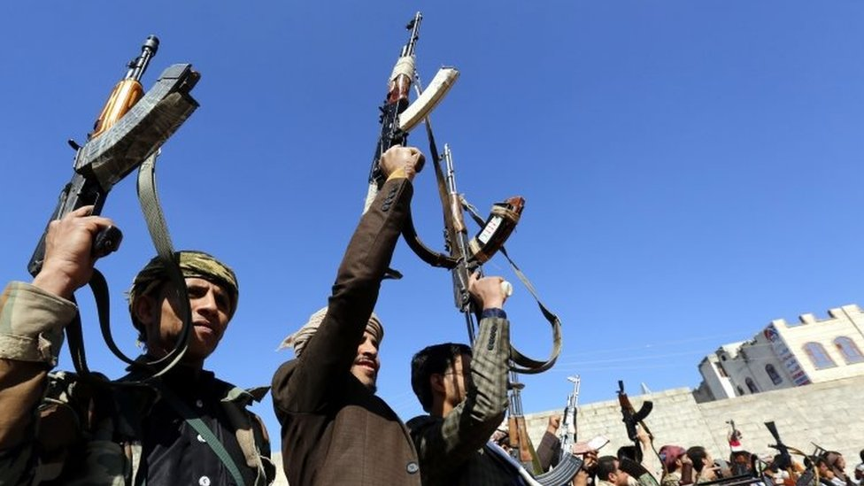 Houthi supporters hold up weapons in Sanaa, Yemen. Photo: 13 December 2018